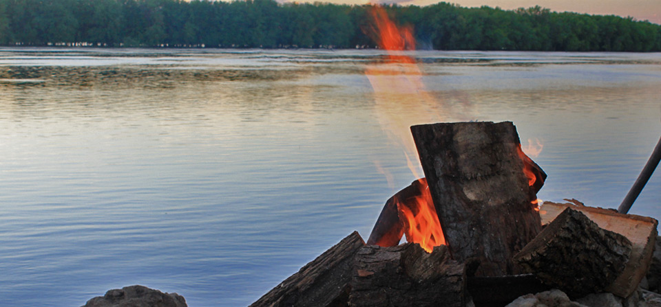 Picture of a campfire with the Mississippi River in the background